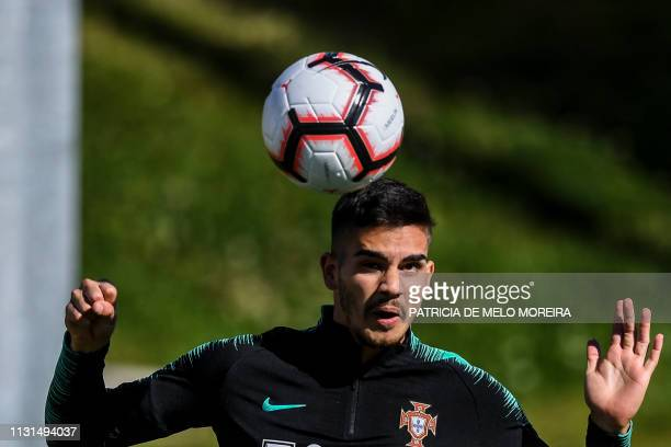Portugal's forward Andre Silva heads the ball during a training session at City of Football training camp in Oeiras outskirts of Lisbon on March 19...