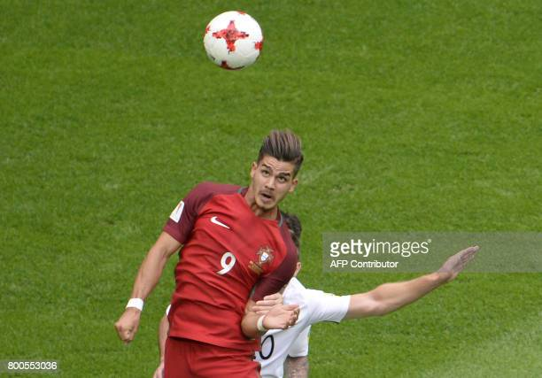 Portugal's forward Andre Silva heads the ball during the 2017 Confederations Cup group A football match between New Zealand and Portugal at the Saint...