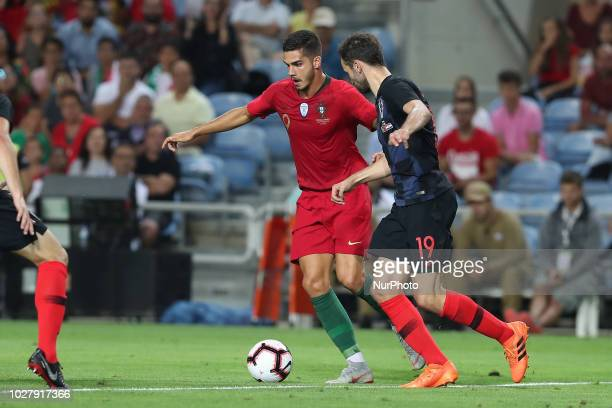 Portugal's forward Andre Silva vies with Croatia's midfielder Milan Badelj during the friendly football match Portugal vs Croatia at the Algarve...