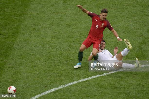 Portugal's forward Andre Silva vies with New Zealand's defender Michael Boxall during the 2017 Confederations Cup group A football match between New...