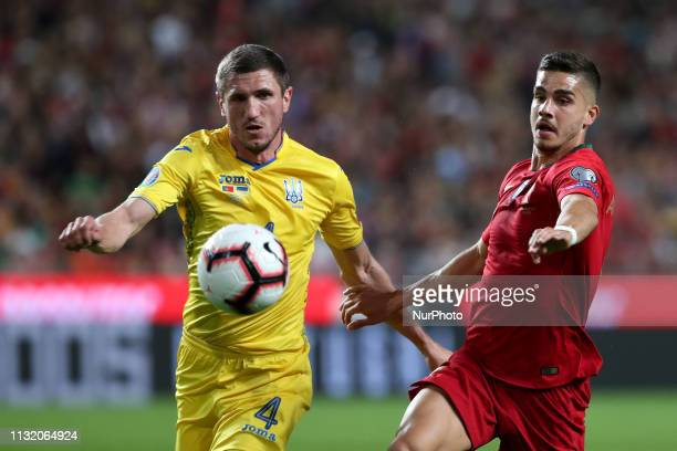 Portugal's forward Andre Silva vies with Ukraine's defender Sergii Kryvtsov during the UEFA EURO 2020 group B qualifying football match Portugal vs...