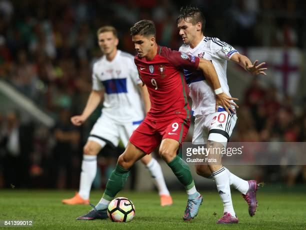 Portugal's forward Andre Silva with Faroe Island defender Rene Joensen in action during the FIFA 2018 World Cup Qualifier match between Portugal and...