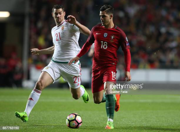 Portugal's forward Andre Silva with HungaryÕs defender Barnabas Bese in action during the FIFA 2018 World Cup Qualifier match between Portugal and...