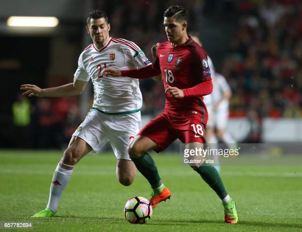 Portugal's forward Andre Silva with Hungary's defender Barnabas Bese in action during the FIFA 2018 World Cup Qualifier match between Portugal and...
