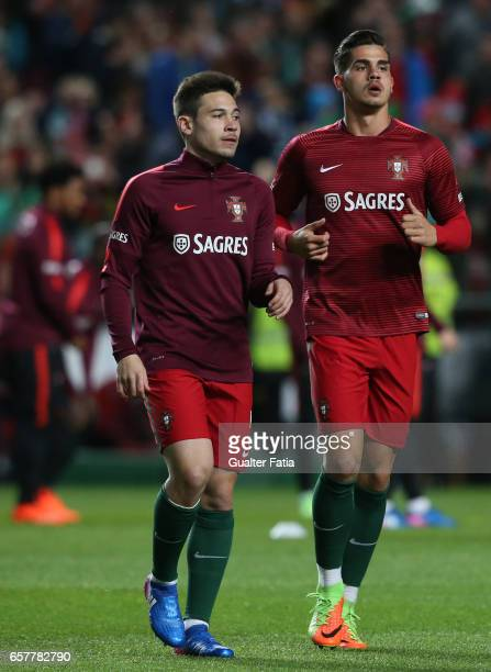 Portugal's forward Andre Silva with Portugal's defender Raphael Guerreiro during warm up before the start of the FIFA 2018 World Cup Qualifier match...