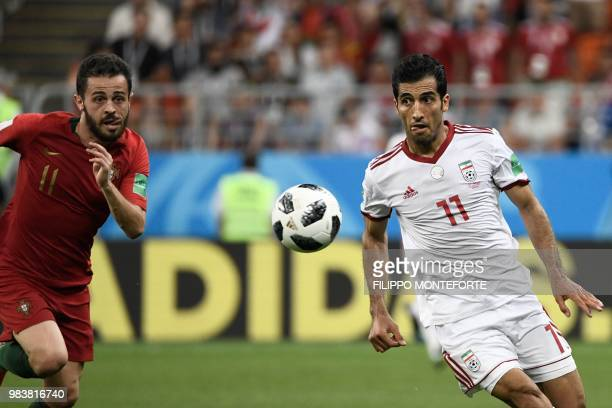 Portugal's forward Bernardo Silva and Iran's forward Vahid Amiri vie for the ball during the Russia 2018 World Cup Group B football match between...