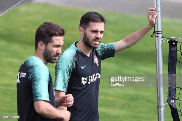 Portugal's forward Bernardo Silva and Portugal's midfielder Joao Moutinho during a training session at Cidade do Futebol training camp in Oeiras,...