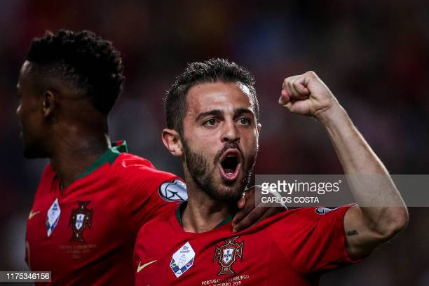 Portugal's forward Bernardo Silva celebrates after scoring a goal during the Euro 2020 qualifier football match between Portugal and Luxembourg at...