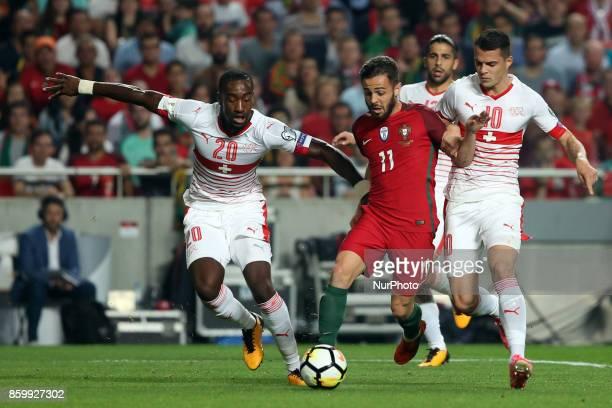 Portugal's forward Bernardo Silva fights for the ball with Switzerland's defender Johan Djourou and Switzerland's midfielder Granit Xhaka during the...