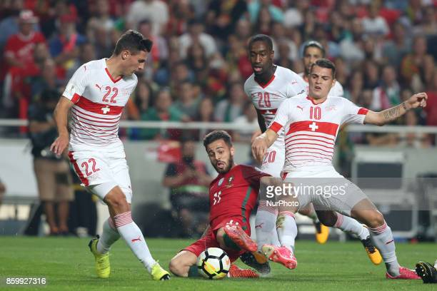 Portugal's forward Bernardo Silva fights for the ball with Switzerland's defender Johan Djourou and Switzerland's midfielder Granit Xhaka during the...