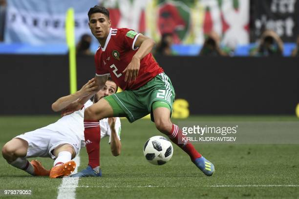 Portugal's forward Bernardo Silva vies for the ball with Morocco's defender Achraf Hakimi during the Russia 2018 World Cup Group B football match...