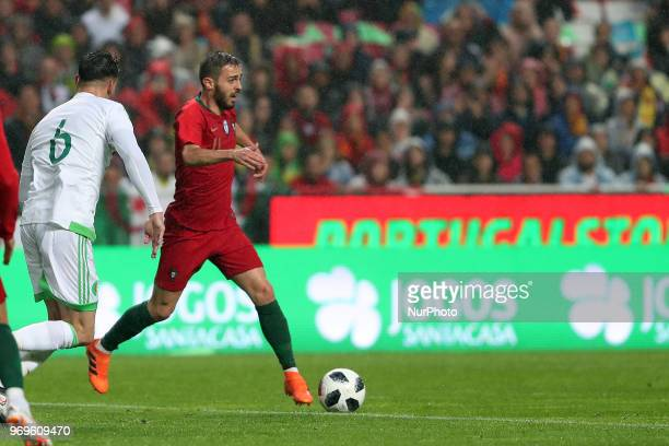 Portugal's forward Bernardo Silva vies with Algerias defender Carl Medjani during the FIFA World Cup Russia 2018 preparation football match Portugal...
