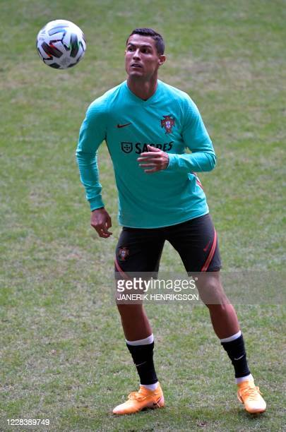 Portugal's forward Christiano Ronaldo takes part in a training session on the eve of the UEFA Nations League football match between Sweden and...