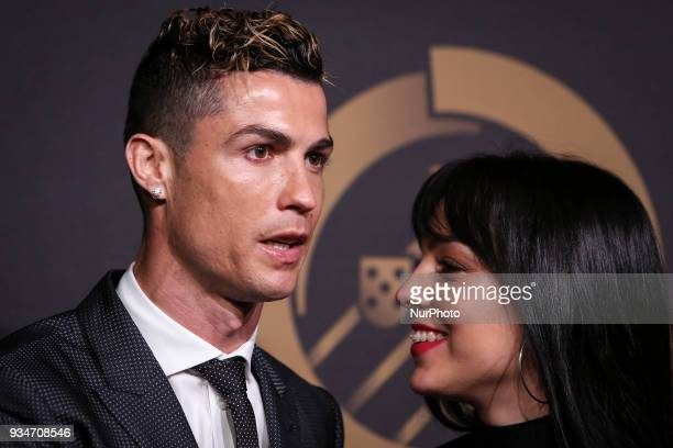 Portugal's forward Cristiano Ronaldo accompanied by Georgina Rodriguez pose on arrival at quotQuinas de Ouroquot ceremony held at Pavilhao Carlos...