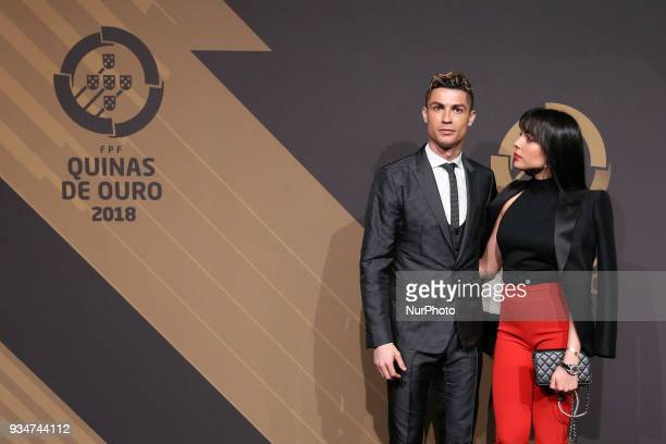 Portugal's forward Cristiano Ronaldo accompanied by Georgina Rodriguez poses on arrival at 'Quinas de Ouro' 2018 ceremony held and the Pavilhao...