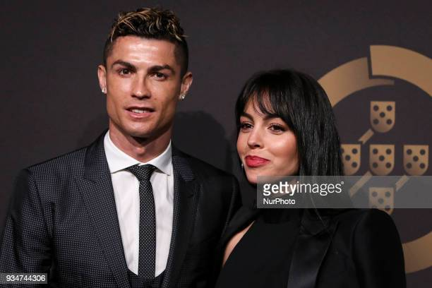Portugal's forward Cristiano Ronaldo accompanied by Georgina Rodriguez pose on arrival at 'Quinas de Ouro' ceremony held at Pavilhao Carlos Lopes in...