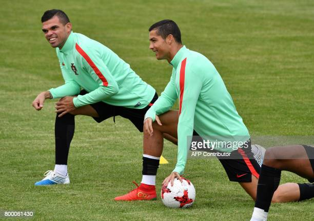 Portugal's forward Cristiano Ronaldo and defender Pepe take part in a training session in Saint Petersburg on June 23 2017 on the eve of the 2017...