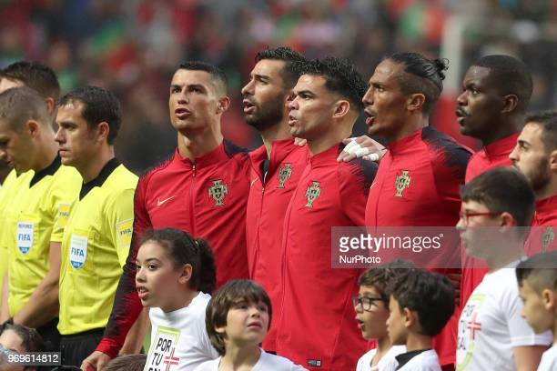 Portugal's forward Cristiano Ronaldo and his teammates sings the national anthem during the FIFA World Cup Russia 2018 preparation football match...