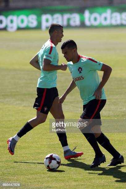Portugal's forward Cristiano Ronaldo and Portugal's defender Pepe in action during a training session at quotCidade do Futebolquot training camp in...