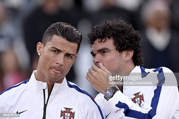 Portugal's forward Cristiano Ronaldo and Portugal's defender Pepe stand during the friendly football match Portugal vs Greece at the Jamor National...