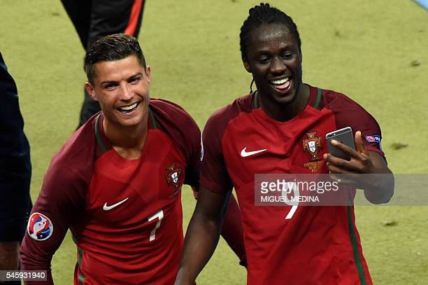 TOPSHOT Portugal's forward Cristiano Ronaldo and Portugal's forward Eder take a selfie as they arrive to receive their medals after the Euro 2016...