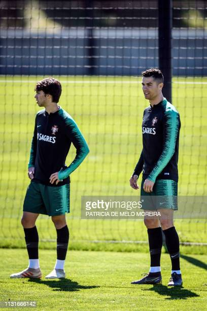 Portugal's forward Cristiano Ronaldo and Portugal's forward Joao Felix attend a training session at City of Football training camp in Oeiras on March...