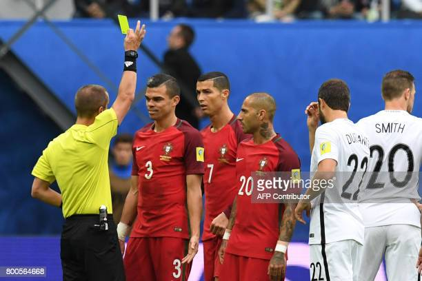 Portugal's forward Cristiano Ronaldo and Portugal's forward Ricardo Quaresma look on as Portugal's defender Pepe receives a yellow card during the...