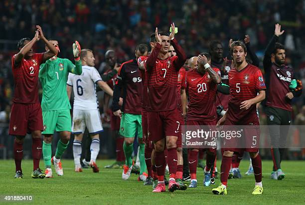 Portugal's forward Cristiano Ronaldo and teammates celebrate the victory during the UEFA EURO 2016 Qualifier match between Portugal and Denmark at...