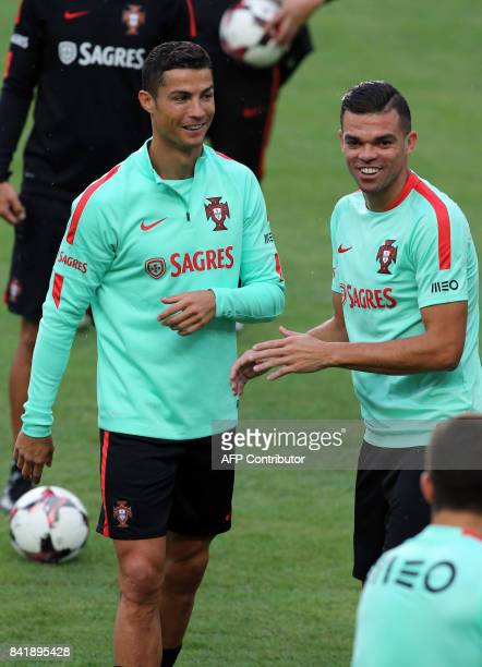 Portugal's forward Cristiano Ronaldo and teammates Pepe take part in a training session at the last training on the eve of the FIFA World Cup 2018...