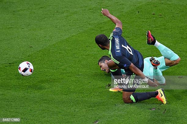 TOPSHOT Portugal's forward Cristiano Ronaldo and Wales' defender Ashley Williams vie for the ball during the Euro 2016 semifinal football match...