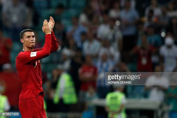 Portugal's forward Cristiano Ronaldo applauds to acknowledge fans at the end of the Russia 2018 World Cup Group B football match between Portugal and...