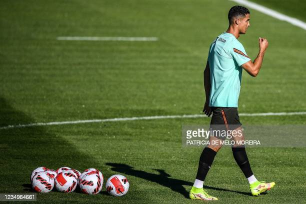 Portugal's forward Cristiano Ronaldo attends a training session at Cidade do Futebol training camp in Oeiras, outskirts of Lisbon, on August 30 ahead...
