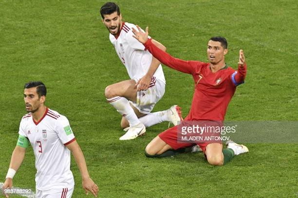 Portugal's forward Cristiano Ronaldo calls for a penalty during the Russia 2018 World Cup Group B football match between Iran and Portugal at the...