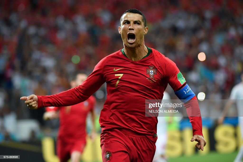 TOPSHOT - Portugal's forward Cristiano Ronaldo celebrates a goal after shooting a penalty kick during the Russia 2018 World Cup Group B football match between Portugal and Spain at the Fisht Stadium in Sochi on June 15, 2018. (Photo by Nelson Almeida / AFP) / RESTRICTED