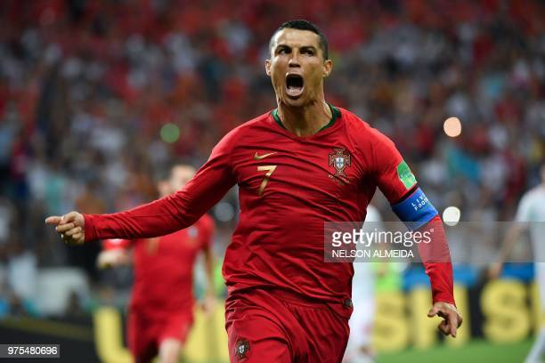 TOPSHOT Portugal's forward Cristiano Ronaldo celebrates a goal after shooting a penalty kick during the Russia 2018 World Cup Group B football match...