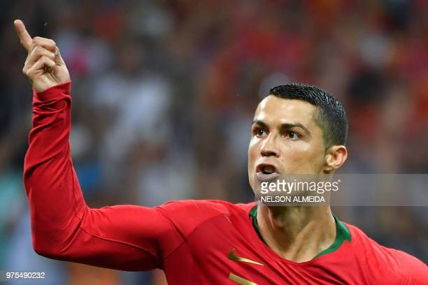 Portugal's forward Cristiano Ronaldo celebrates a goal after shooting a penalty kick during the Russia 2018 World Cup Group B football match between...