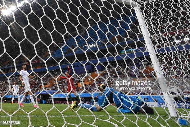 TOPSHOT Portugal's forward Cristiano Ronaldo celebrates after Portugal's forward Ricardo Quaresma scored the opening goal past Iran's goalkeeper...