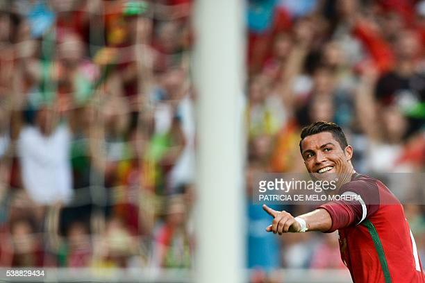 TOPSHOT Portugal's forward Cristiano Ronaldo celebrates after scored against Estonia during the friendly football match Portugal vs Estonia at Luz...