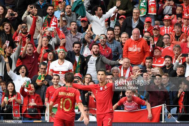 Portugal's forward Cristiano Ronaldo celebrates after scoring a goal during the UEFA Nations League semi-final football match between Portugal and...