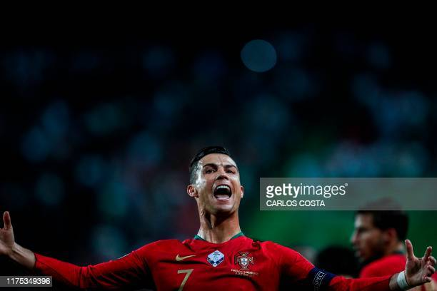 Portugal's forward Cristiano Ronaldo celebrates after scoring a goal during the Euro 2020 qualifier group B football match between Portugal and...
