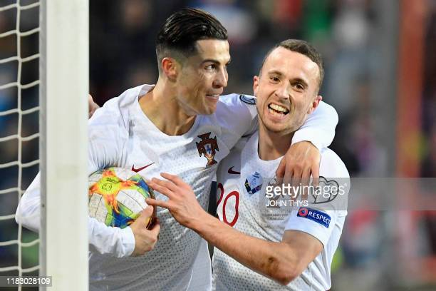 Portugal's forward Cristiano Ronaldo celebrates after scoring a goal during the UEFA Euro 2020 Group B qualification football match between...