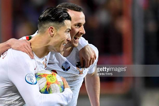 Portugal's forward Cristiano Ronaldo celebrates after scoring a goal with Portugal's forward Diogo Jota during the UEFA Euro 2020 Group B...