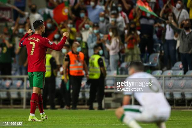 Portugal's forward Cristiano Ronaldo celebrates after scoring a goal during the FIFA World Cup Qatar 2022 European qualifying round group A football...
