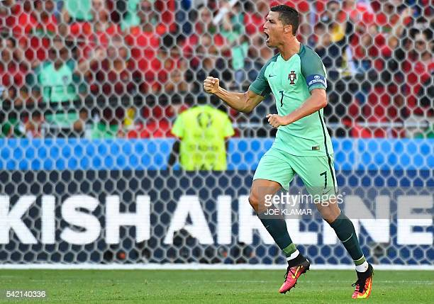 Portugal's forward Cristiano Ronaldo celebrates after scoring a goal during the Euro 2016 group F football match between Hungary and Portugal at the...