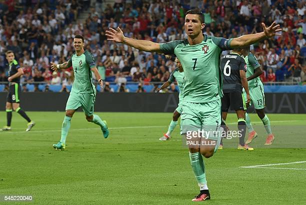Portugal's forward Cristiano Ronaldo celebrates after scoring a goal during the Euro 2016 semifinal football match between Portugal and Wales at the...