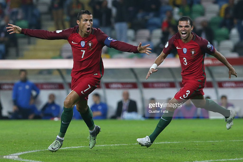 Portugal's forward Cristiano Ronaldo celebrates after scoring a goal during the FIFA 2018 World Cup Qualifier match between Portugal and Andorra at Estadio Municipal de Aveiro on October 7, 2016 in Lisbon, Portugal.