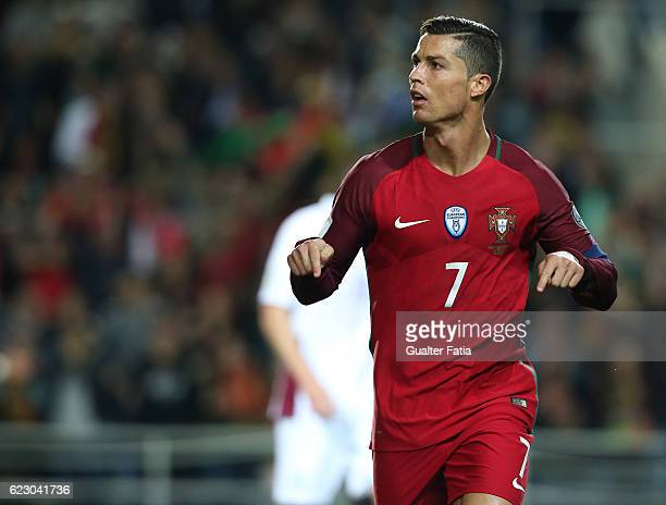 Portugal's forward Cristiano Ronaldo celebrates after scoring a goal during the FIFA 2018 World Cup Qualifier match between Portugal and Latvia at...