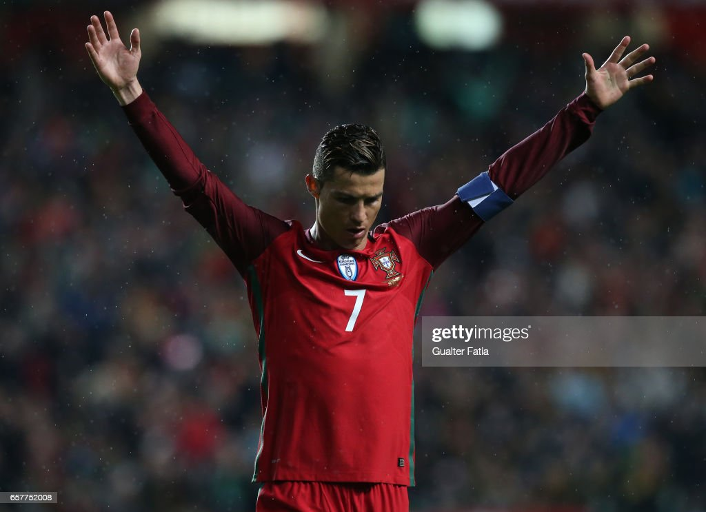 Portugal's forward Cristiano Ronaldo celebrates after scoring a goal during the FIFA 2018 World Cup Qualifier match between Portugal and Hungary at Estadio da Luz on March 25, 2017 in Lisbon, Portugal.