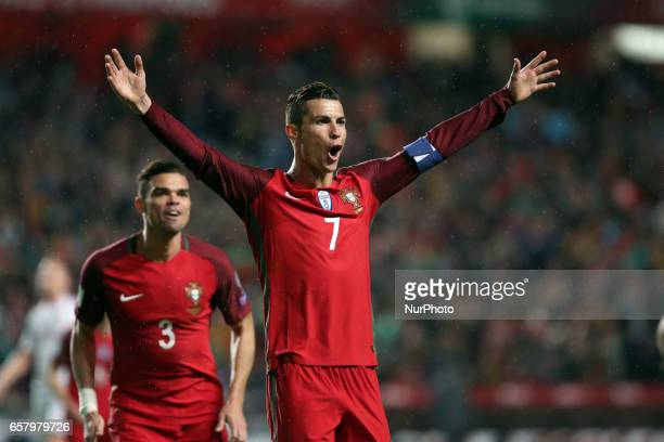 Portugal's forward Cristiano Ronaldo celebrates after scoring a goal during the FIFA World Cup Russia 2018 qualifier match Portugal vs Hungary at the...