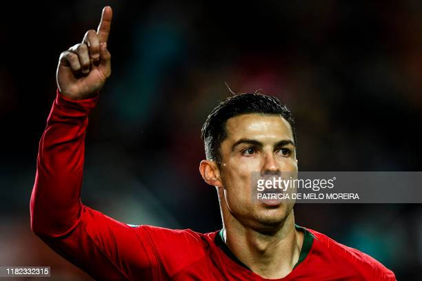 TOPSHOT Portugal's forward Cristiano Ronaldo celebrates after scoring a penalty during the Euro 2020 Group B football qualification match between...